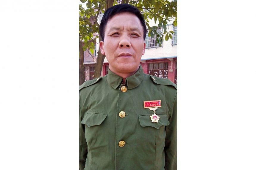 This undated mobile phone picture shows former Chinese Vietnam veteran soldier Teng Xingqiu in military uniform. Marginalised and misunderstood, Chinese Vietnam veterans -- who fought in a little-celebrated war with its southern neighbour -- risk bea