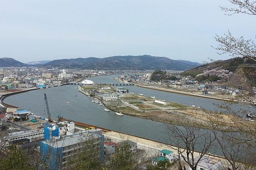 Three years after the 2011 earthquake and tsunami, the city of Ishinomaki, in Japan's Miyagi prefecture, still shows scars from the disaster. -- ST PHOTO: DANIEL WONG