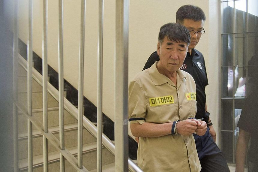 Lee Joon Seok, captain of sunken ferry Sewol, arrives at a court in Gwangju on June 10, 2014. Fifteen crew members of a South Korean ferry that sank in April killing more than 300 people, most of them children, went on trial on Tuesday, June 10,