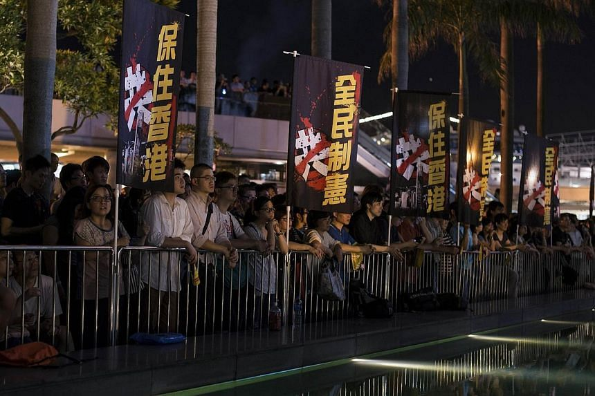 Pro-democracy activists hold a rally to mark the 1989 Tiananmen Square military crackdown, in the Tsim Sha Tsui area of Hong Kong on June 4, 2014.China warned Hong Kong on Tuesday, June 10, 2014, that there were limits to its freedom and it sho