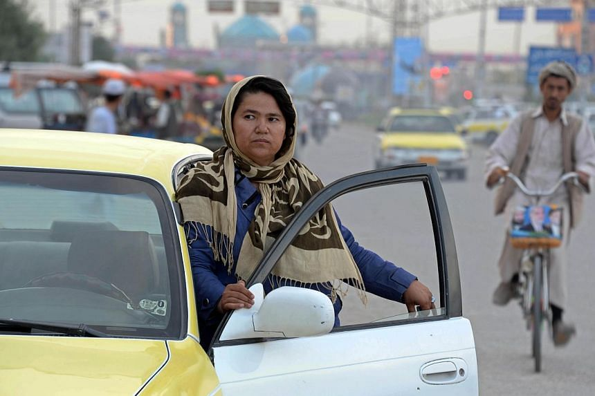 When Afghan taxi driver Sara Bahai has male passengers in her cab, she takes the chance to lobby them on female rights - and she hopes the country's next president will also listen to her arguments. -- PHOTO: AFP