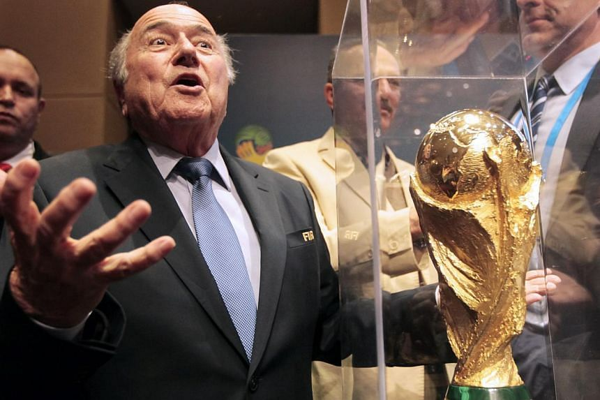 World football chief Sepp Blatter vowed to fight critics trying to destroy Fifa on Monday as he launched a staunch defence of his scandal-tainted organisation. -- PHOTO: REUTERS