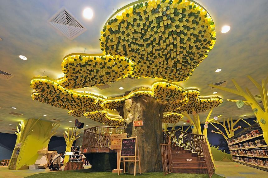 "Visitors to the Singapore Book Fair can go to My Tree House, a ""green library"" which is based on the one atthe Central Public Library (above) in Victoria Street. -- ST FILE PHOTO"