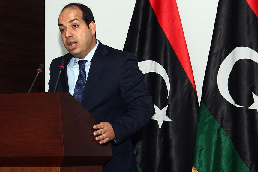 Libya's supreme court on Monday ruled as unconstitutional the interim parliament's election of premier Ahmed Miitig, seemingly ending a month-long crisis that saw two rival cabinets jostling for power. -- PHOTO: AFP