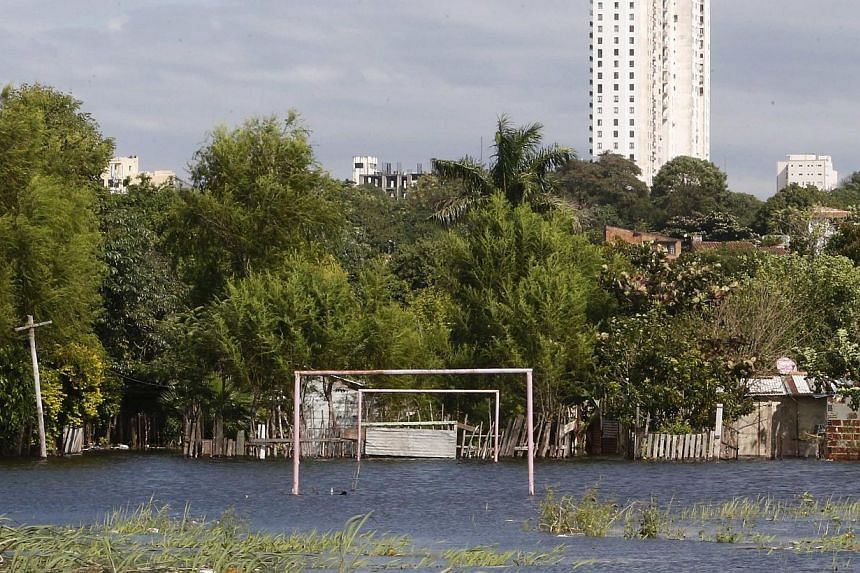 Goalposts stand in a soccer field flooded by the waters of the Paraguay River in Asuncion on May 30, 2014. -- PHOTO: REUTERS