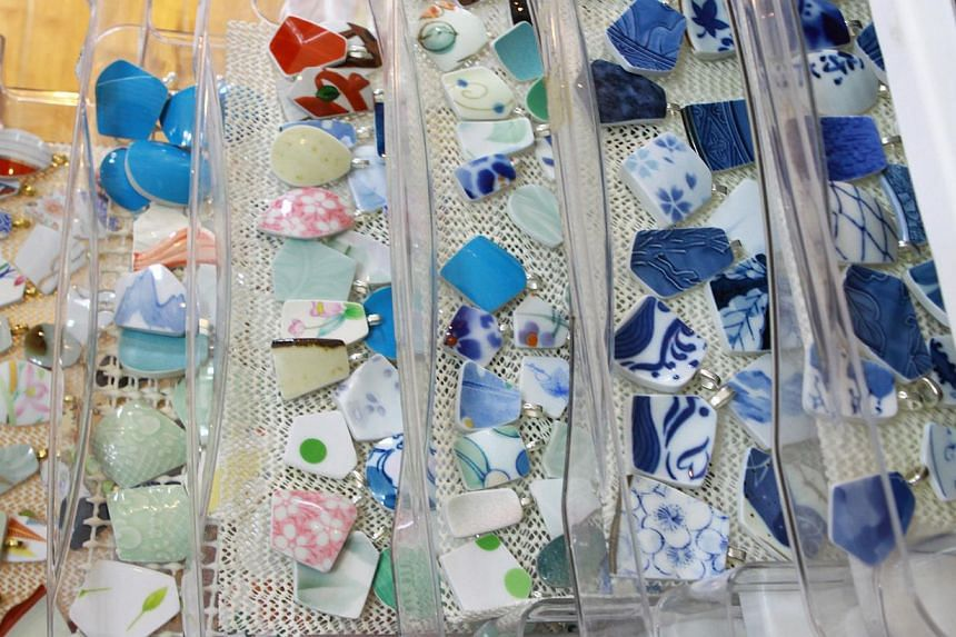 Pieces of broken pottery that were picked up by a team of volunteers. The pieces are washed and then cut down to size to be used to make jewellery.After the shards are polished, they are separated based on their shape, size and colour (above).