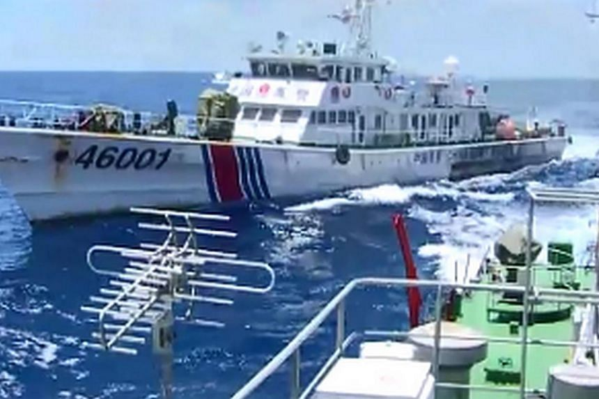 This video grab image taken on June 1, 2014 from Vietnam Coast Guard ship 2016 and released on June 5, 2014 shows the Chinese Coast Guard ship 46001 (L) chasing a Vietnamese vessel near to the site of the Chinese oil rig in disputed waters in the Sou
