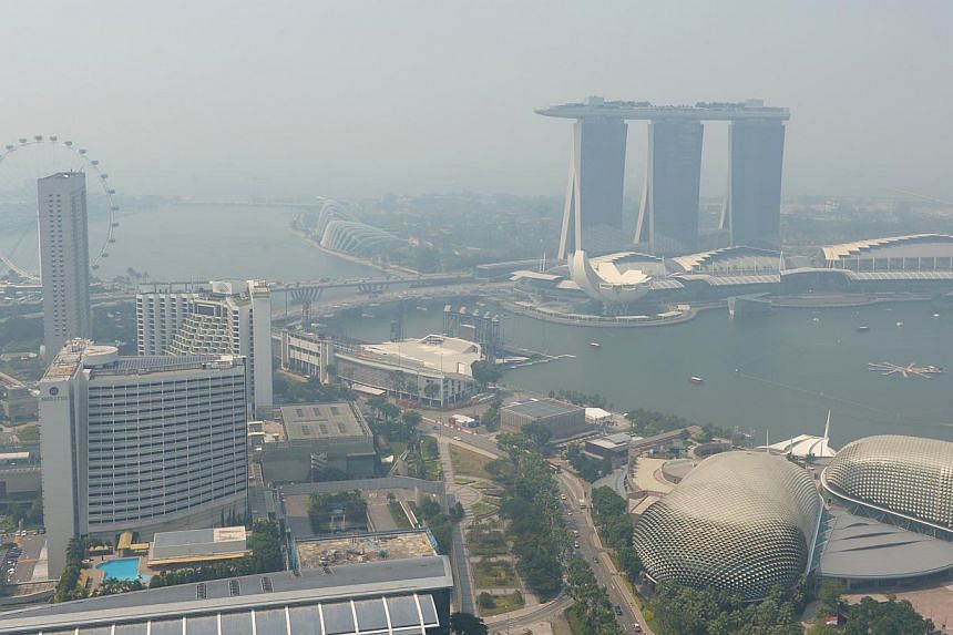 The hazy Singapore skyline on June 18, 2013, taken from the 56th floor of Swissotel The Stamford Singapore. -- ST PHOTO: JAMIE KOH