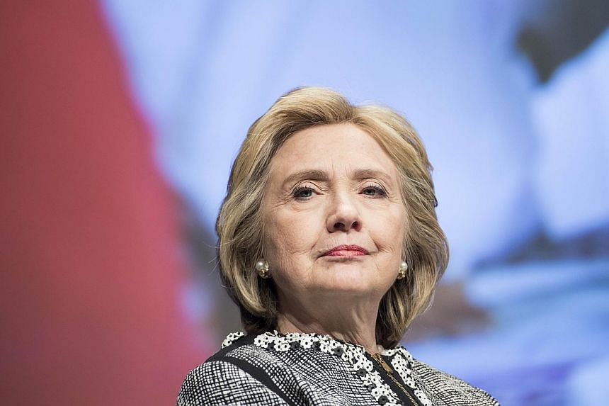 Hillary Clinton (above) in her new book passionately defended her role in the release of Chinese dissident Chen Guangcheng, criticising Republican assertions that the United States pressured him. -- PHOTO: AFP