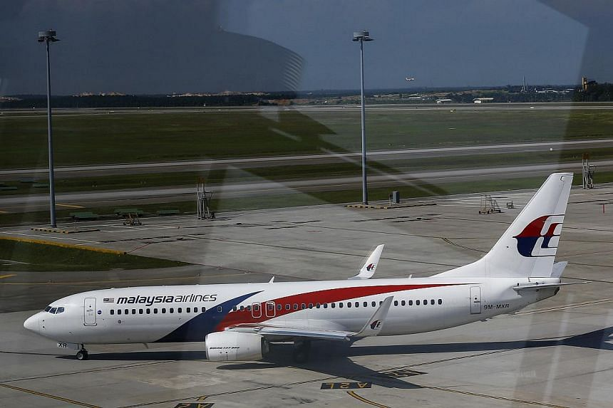 A Malaysia Airlines Boeing 737-800 aircraft is seen on tarmac of Kuala Lumpur International Airport in Sepang on May 21, 2014. -- PHOTO: REUTERS