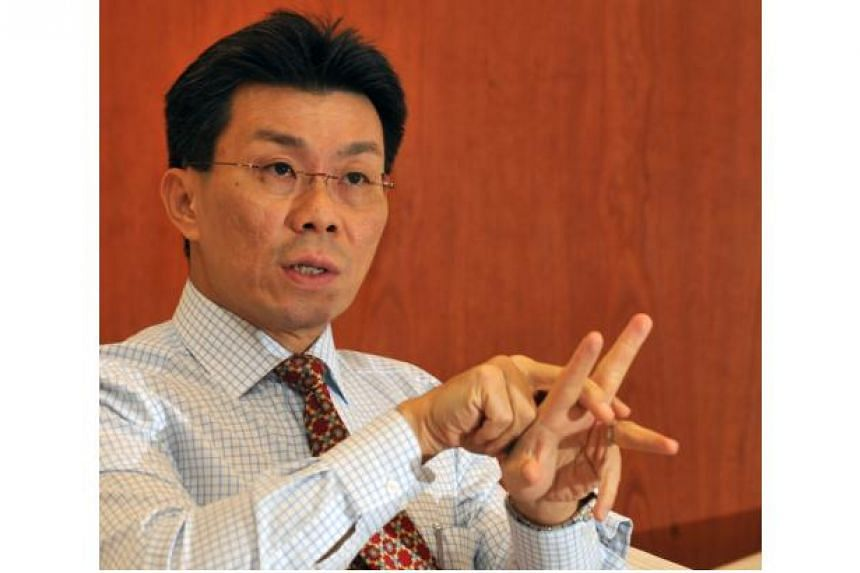 The Singapore Badminton Association (SBA) has re-elected Lee Yi Shyan as its chief for the fourth running term, after holding its annual general meeting last weekend. -- ST PHOTO:ARTHUR LEE CH