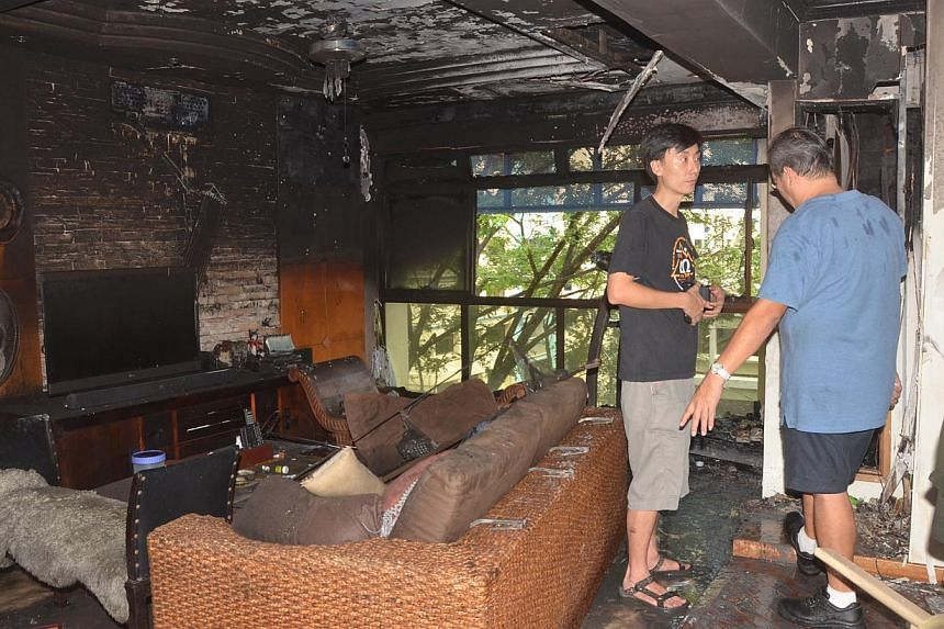 Aftermath of fire at Woodlands Crescent flat.A 57-year-old man died in his flat at Woodlands Crescent when a fire broke out on Tuesday morning, June 10, 2014. -- PHOTO:SHIN MIN