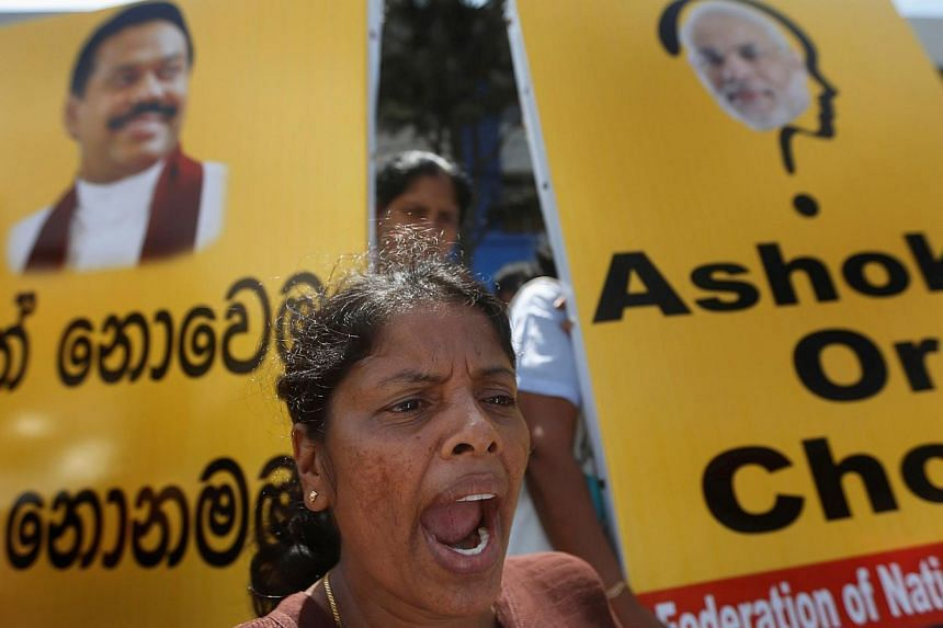 A demonstrator from the Freedom of National Organization shouts slogans against Indian Prime Minister Narendra Modi, outside the Indian High Commission to Sri Lanka, in Colombo on June 10, 2014.Hundreds of activists protested in the Sri Lankan