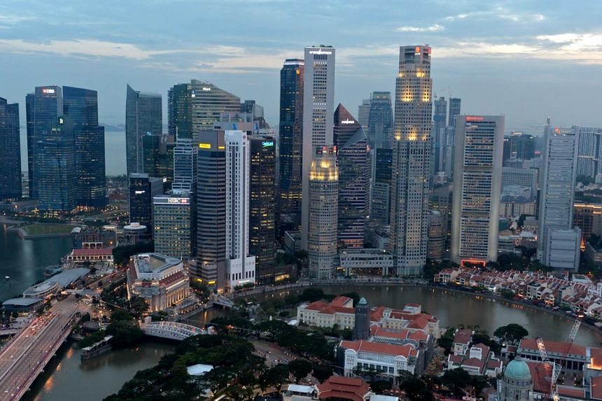 The Singapore skyline as seen from Swissotel the Stamford at dusk on Sept 16, 2013.Singapore is becoming increasingly expensive for expatriates, after another survey said that the island state is becoming more costly for foreigners working here