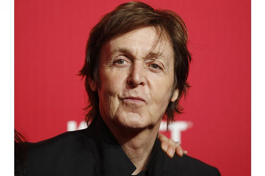 Former Beatle Paul McCartney, following his doctors' orders as he recovers from a viral illness after falling ill in Japan last month, has rescheduled some US dates on his world tour. -- PHOTO: REUTERS