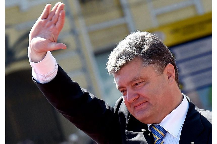 The meetings in Brussels and Kiev are the first challenges for new Ukrainian President Petro Poroshenko (above) who has vowed dialogue with Moscow to try to prevent the bitterly divided former Soviet state from splitting. -- PHOTO: AFP