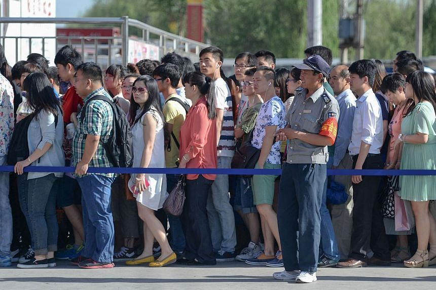 "China's capital Beijing on Tuesday launched a new effort to ""civilise"" its residents by clamping down on queue-jumping and smoking ahead of a summit for Asian leaders later this year. -- PHOTO: AFP"