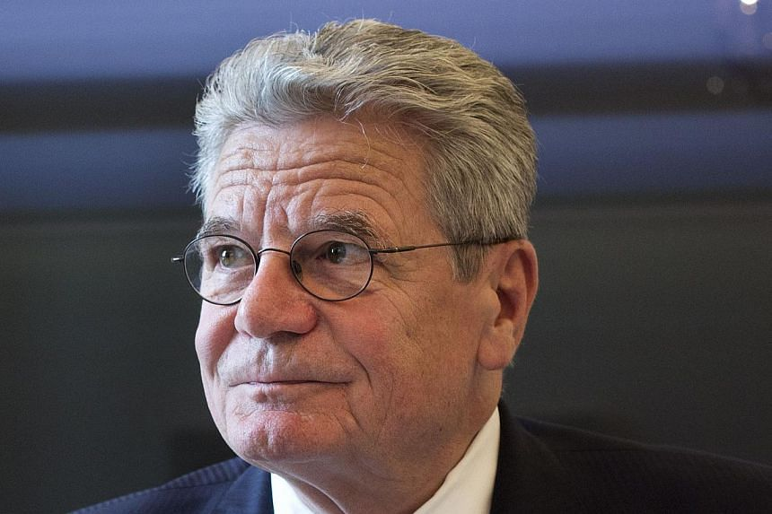 """This photo taken on May 6, 2013, shows German President Joachim Gauck at his desk at the Bellevue presidential palace in Berlin.Germany's President Joachim Gauck has the right to call members of a neo-Nazi party """"loonies"""", the country's top cou"""
