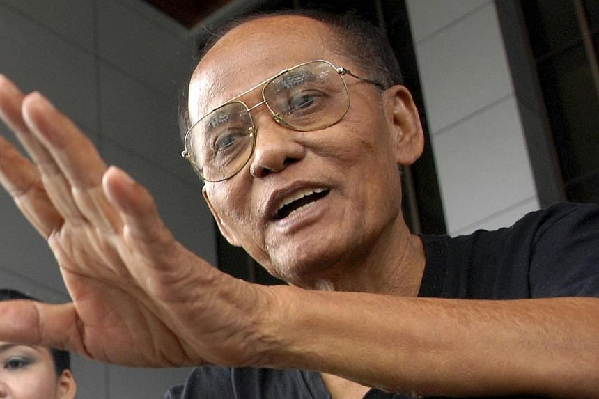 Retired navy lieutenant and serial hunger striker Chalad Vorachatgestures as he sits on the steps of the criminal court in Bangkok on June 10, 2014.A Thai political activist who has started a hunger strike in protest against last month's