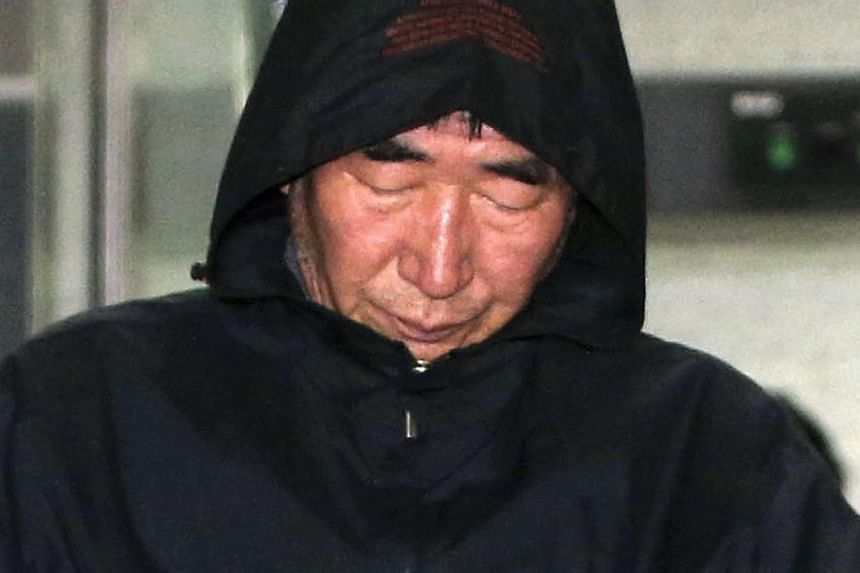 Lee Joon Seok, captain of South Korean ferry Sewol which sank at sea off Jindo, walks out of court after an investigation in Mokpo on April 19, 2014. -- PHOTO: REUTERS