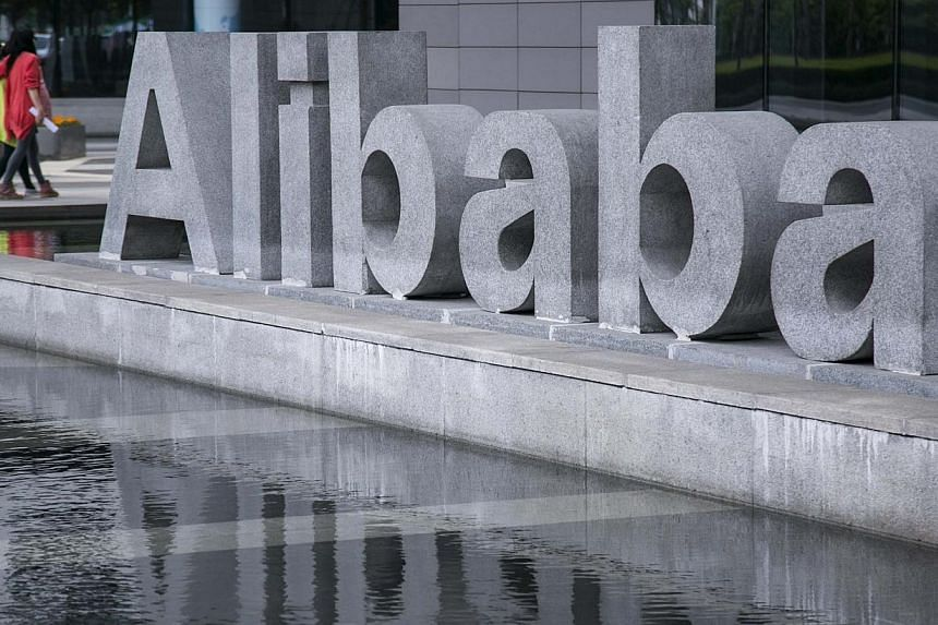 People walk at the headquarters of Alibaba in Hangzhou, Zhejiang province, April 23, 2014.Chinese e-commerce company Alibaba Group Holding unveiled its first direct-to-consumer online shop in the United States on Wednesday, looking to take on A