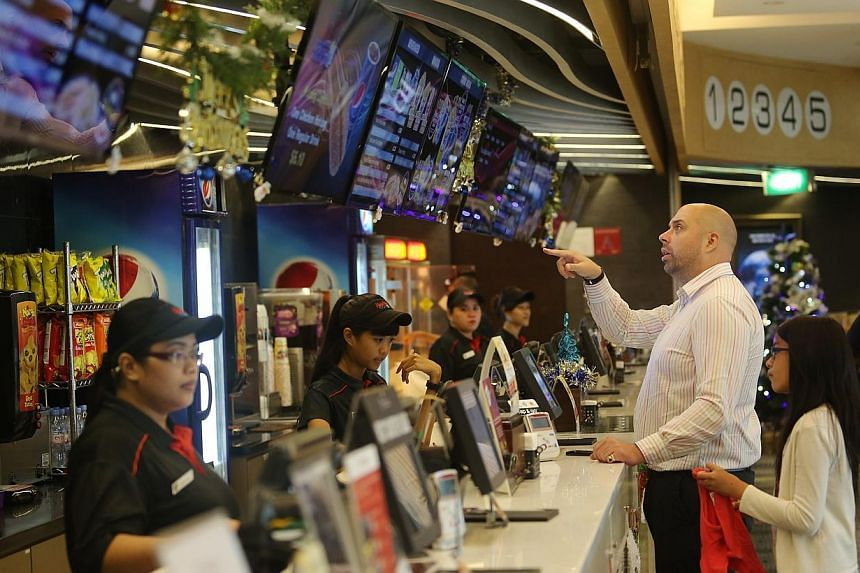 People at Cathay Jem cinema. Singaporeans are paying more to catch their favourite celebrities on the big screen.-- PHOTO: ST FILE