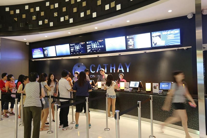 People at the ticket counter at Cathay Jem cinema.-- PHOTO: ST FILE