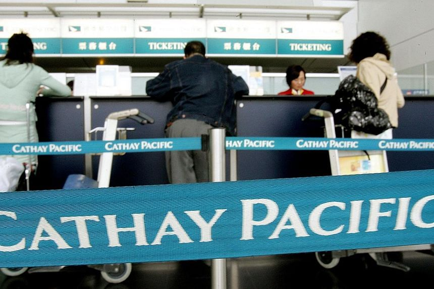 Customers get assistance at a Cathay Pacific ticketing counter at Hong Kong's Chek Lap Kok airport, March 9, 2005.Cathay Pacific Airways has cancelled all flights to the Pakistani city of Karachi from Bangkok following a Taleban raid on the cou