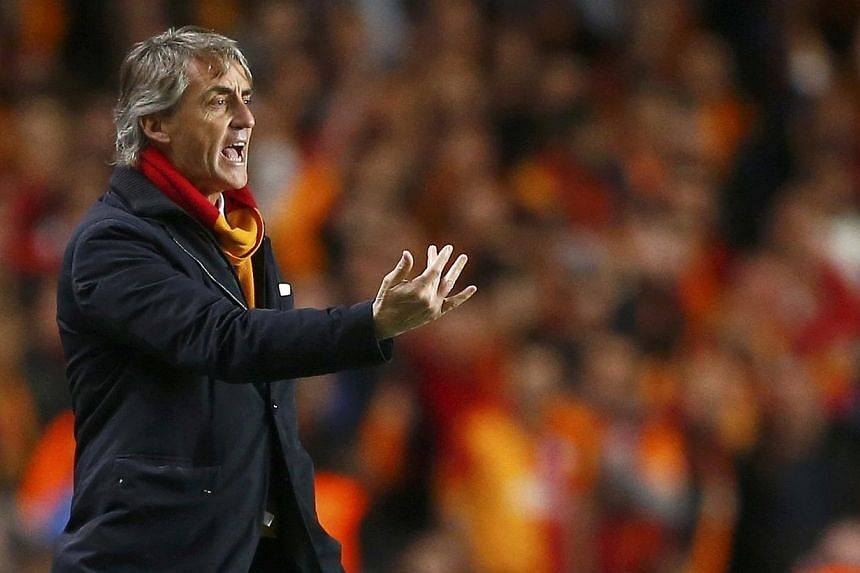 Galatasaray's coach Roberto Mancini gestures during their Champions League soccer match against Chelsea at Stamford Bridge in London March 18, 2014. Mancini has left Turkish giants Galatasaray by mutual consent after one season, the club announced on