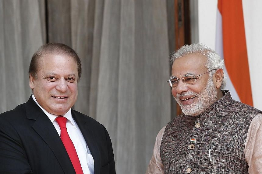 India's Prime Minister Narendra Modi (right) and his Pakistani counterpart Nawaz Sharif smile before the start of their bilateral meeting in New Delhi May 27, 2014.Mr Sharif has written to his new Indian counterpart to express satisfaction with