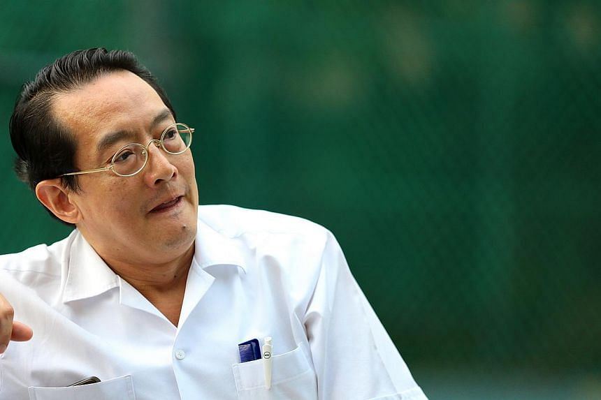 Well-known plastic surgeon Woffles Wu is being sued by a patient for $400,000 in damages over his alleged negligence in her treatment. -- PHOTO: TNP FILE