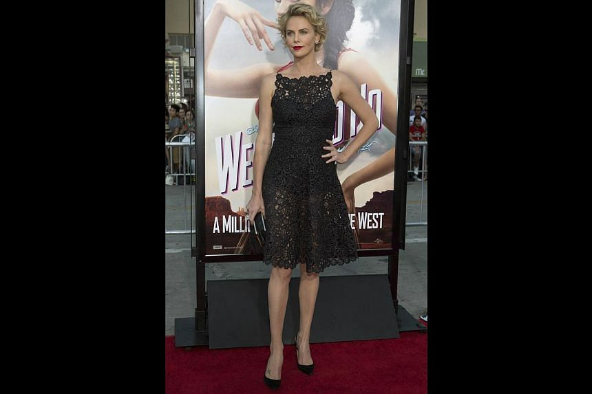 Actress Charlize Theron (above), who played a prostitute-turned-serial killer in the 2003 drama Monster and now stars in a comedy, A Million Ways To Die In The West. -- PHOTO: REUTERS