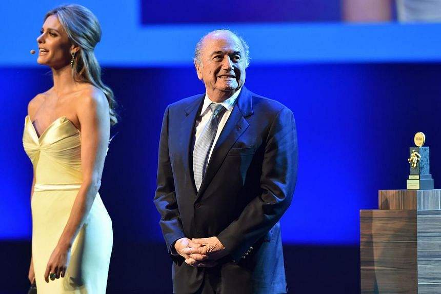 President of FIFA Sepp Blatter (right) stands on stage during the opening ceremony of the FIFA Congress in Sao Paulo on June 10, 2014. -- PHOTO: AFP