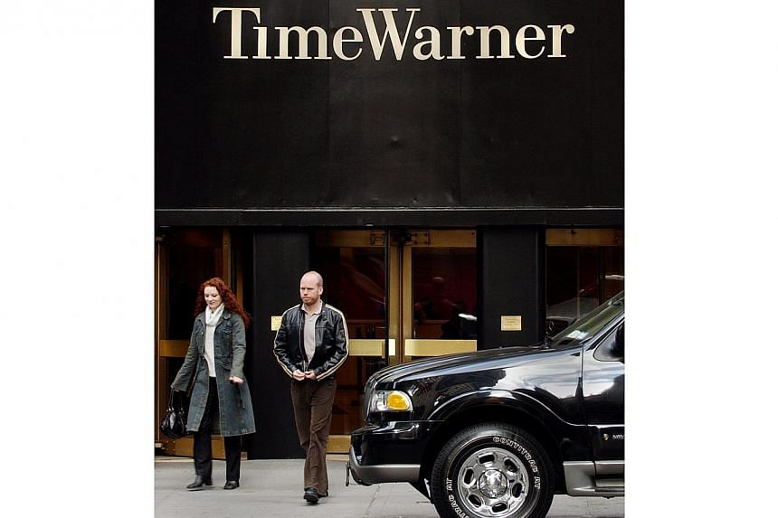In this November 24, 2003 file photo, the headquarters of Time Warner company is seen in New York. US media conglomerate Time Warner has begun talks for a stake in the fast-growing online news operation Vice Media, reports said. -- PHOTO: AFP