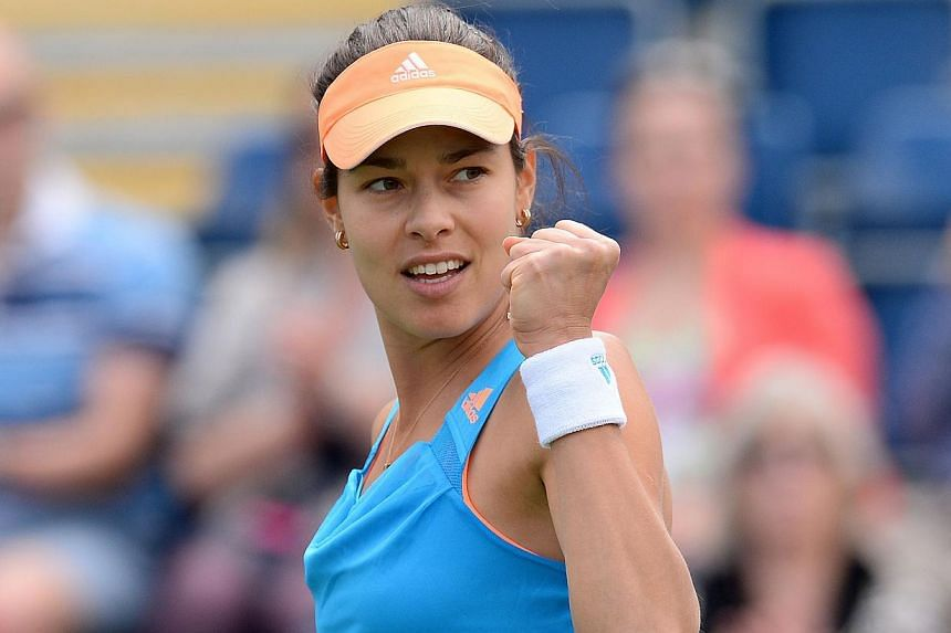Serbia's Ana Ivanovic reacts during her second round match against Germany's Mona Barthel of at the WTA Aegon Classic tennis tournament at Edgbaston Priory Club, Birmingham, central England, on June 10, 2014. -- PHOTO: AFP