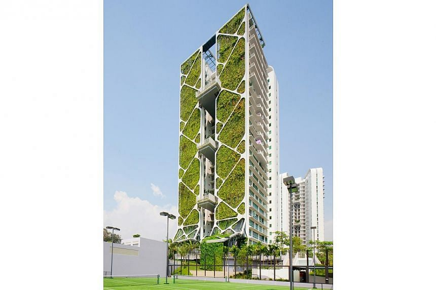 A 24-storey green belt at Tree House condominium in Bukit Timah clinched a Guinness World Record on Wednesday for its sheer size. -- PHOTO: CDL