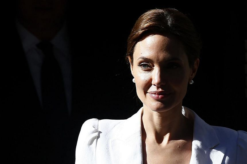 Actress and campaigner Angelina Jolie leaves 10 Downing Street after meeting Britain's Prime Minister David Cameron in London June 10, 2014. -- PHOTO: REUTERS