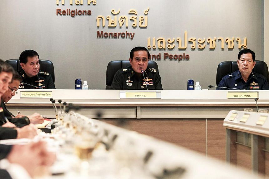 Thai Army chief, General Prayuth Chan-ocha, speaking during a meeting with Thai ambassadors at the Royal Thai Army Headquarters in Bangkok on June 11, 2014. A delegation of Thai military commanders travelled to China on Wednesday for talks on regiona
