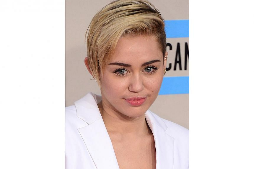 US pop star Miley Cyrus at the 2013 American Music Awards in Los Angeles on Nov 24, 2013. -- PHOTO: AFP