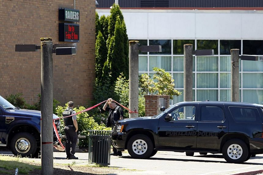 Police officers enter the building after a shooting at Reynolds High School in Troutdale, Oregon on June 10, 2014. -- PHOTO: REUTERS