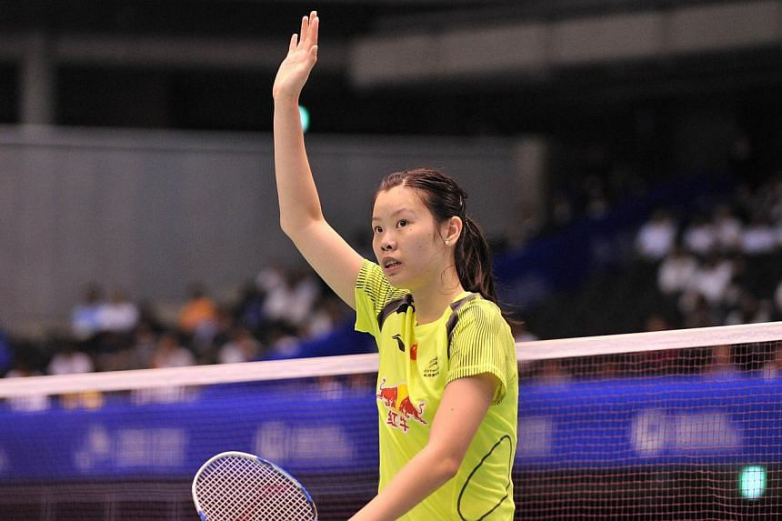 China's Li Xuerui celebrates after beating Japan's Akane Yamaguchi during their women's singles first round match at the Japan Open badminton tournament in Tokyo on June 11, 2014.China's Olympic badminton champion Li Xuerui survived a scare in