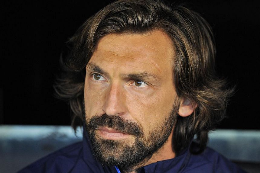 Italy playmaker Andrea Pirlo has signed a new two-year deal with Juventus which will keep him at the Serie A football champions until 2016, the club said on Wednesday. -- PHOTO: AFP