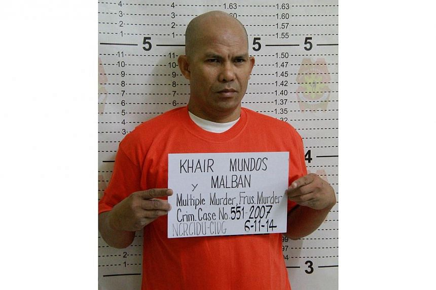 This handout photo taken on June 11, 2014, and released by the Philippine National Police shows senior Philippine Islamic militant Khair Mundos posing for his mugshot after he was arrested in Manila following a manhunt lasting seven years. -- PH
