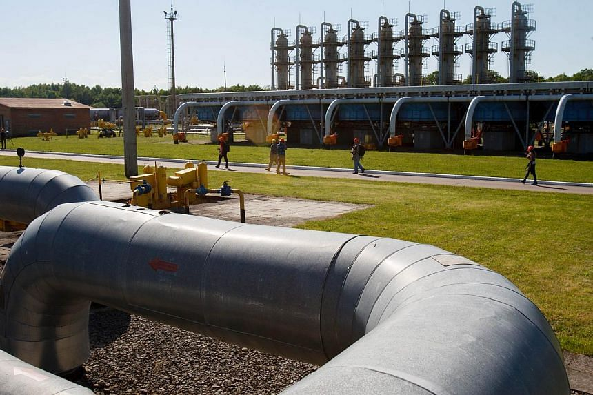 """Employees walk on a path at the Bilche-Volytsko-Uherske underground gas storage facility, the largest in Europe, not far from the village of Bilche village, in the Lviv region of western Ukraine, on May 21, 2014.Russia has offered Ukraine a """"di"""