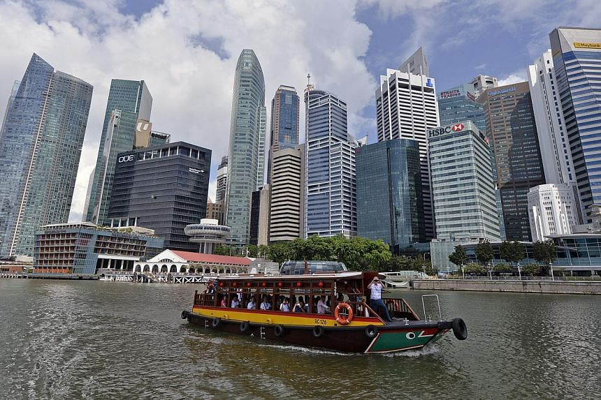 Economists see 3.3% growth for Singapore in Q2. This is up from the 3 per cent growth forecast in a similar survey conducted in March. -- ST PHOTO: DESMOND FOO