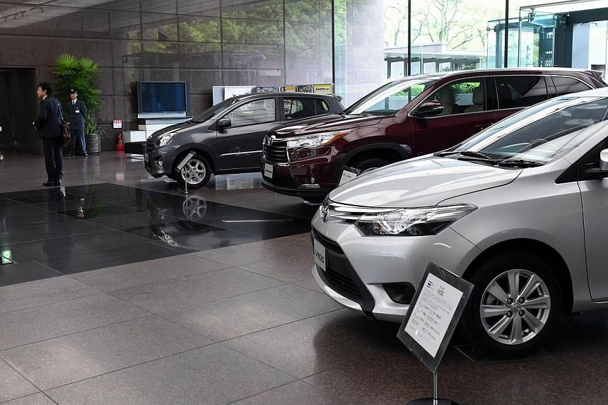 Vehicles are displayed at Toyota Motors' Tokyo headquarters on May 8, 2014. -- PHOTO: AFP