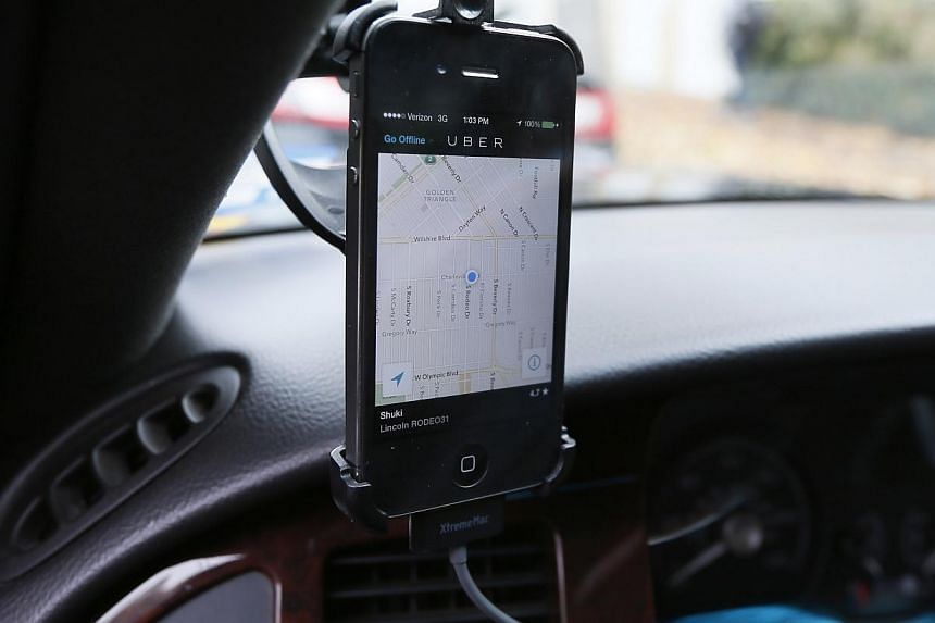Transportation app Uber is seen on the iPhone of limousine driver in Beverly Hills, California, on Dec 19, 2013. -- PHOTO: AFP