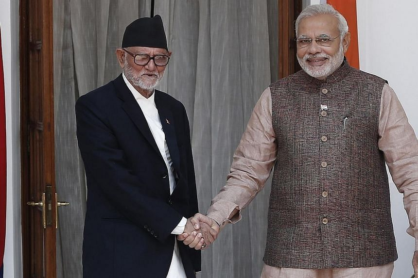 India's Prime Minister Narendra Modi (right) shakes hands with his Nepalese counterpart Sushil Koirala before the start of their bilateral meeting in New Delhi May 27, 2014. Nepalese Prime Minister Sushil Koirala will travel to the United States