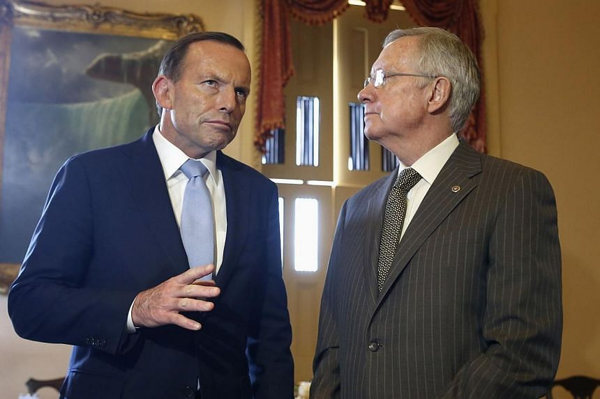 "Australian Prime Minister Tony Abbott (left) and U.S. Senate Majority Leader Harry Reid meet on Capitol Hill in Washington June 11, 2014. Prime Minister Tony Abbott vowed on Thursday that Australia would be the ""most dependable friend"" of the Un"