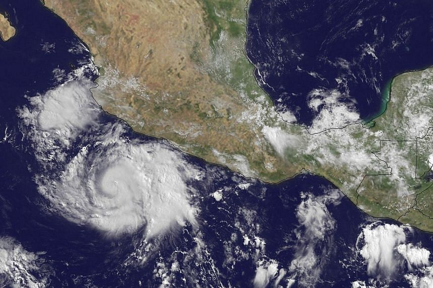 This National Oceanic and Atmospheric Administration satellite photo taken by GOES-13 at 1445Z on June 11, 2014 shows Hurricane Cristina. Hurricane Cristina strengthened on Thursday, June 12, 2014, into a powerful Category 4 storm, but remained